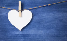 Blank white heart over wood wall Stock Photos
