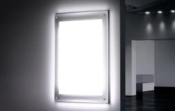 Blank white illuminated poster mock up in dark hall Stock Photos