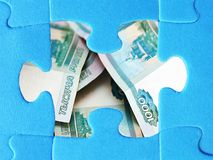 Blank white jigsaw puzzle piece, russian money. Finance Stock Images