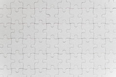 Blank white jigsaw puzzle pieces completed Royalty Free Stock Photography