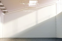 Blank white large wall mockup in sunny modern hangar hall Royalty Free Stock Photography