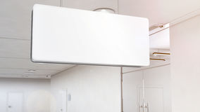 Blank white light signage mockup hanging on ceiling, clipping path royalty free stock photo
