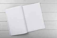 Blank white magazine on wooden table Royalty Free Stock Photography