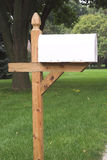 Blank White Mailbox 2. Newly installed mailbox on wooden post...ready for copy and graphics Royalty Free Stock Images