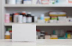 Blank white medicine box. With blur shelves of drug in the pharmacy drugstore background Royalty Free Stock Photography