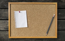 Blank white memo pad on notice board Royalty Free Stock Image