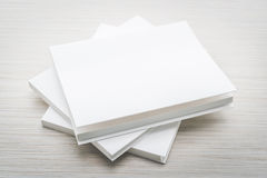 Blank white mock up book. On wooden background - filter effect processing Royalty Free Stock Image