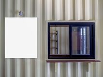 Blank white mock up poster frame on shipping container wall building with window glass. stock photo