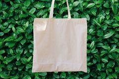 Mockup Linen Cotton Tote Bag on Green Bush Trees Foliage Background. Eco Nature Friendly. Environmental Conservation Recycling Stock Images