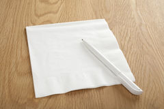 Blank White Napkin or Serviette and Pen Royalty Free Stock Photo