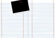 Blank white notebook. Blank white lined notebook page with a photo frame royalty free stock photo