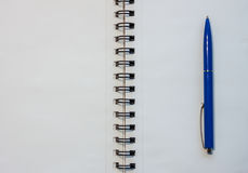 Blank white notebook and blue pen. New project concept Royalty Free Stock Image