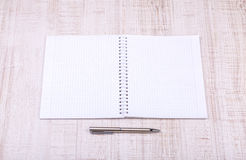 Blank white notebook on the desk Stock Photos