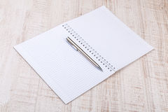 Blank white notebook on the desk Stock Photography