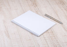 Blank white notebook on the desk Stock Photo