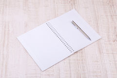 Blank white notebook on the desk Royalty Free Stock Photos