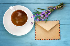 Blank white notebook,envelope, bunch of lavender and cup of coff Royalty Free Stock Images