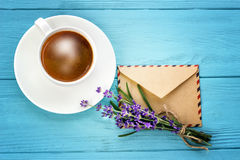 Blank white notebook,envelope, bunch of lavender and cup of coff Stock Photo