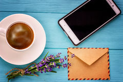 Blank white notebook, envelope, phone,bunch of lavender and cup Stock Photography