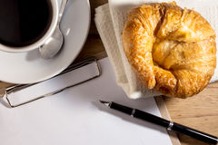 Blank white notebook,pen,coffee and croissant Royalty Free Stock Photo
