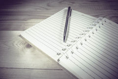 Blank white notebook and pen with copyspace on wood background, Stock Image