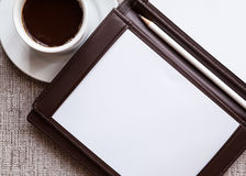 Blank white notebook, pen and cup of coffee Stock Photos