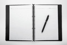 Blank white notebook with a pen royalty free stock image