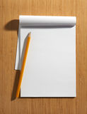 Blank white notepad with a pencil Royalty Free Stock Image