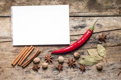 Blank White Notepad with Spices on wooden Board. Kitchen Utensil Royalty Free Stock Photography
