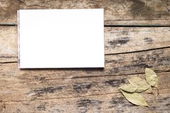 Blank White Notepad with Spices on wooden Board. Kitchen Utensil Stock Photo