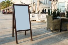 Blank white outdoor advertising stand sandwich board mock up template stock photo
