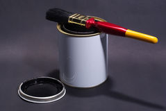 Blank White Paint Tin With Paintbrush on top and lid in Foreground Stock Photos