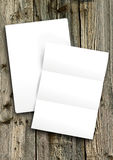 Blank white paper. On wooden background Stock Images