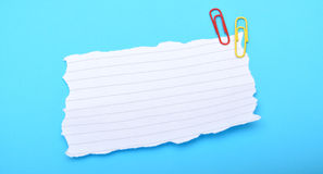 Blank White Paper on blue background with copyspace Royalty Free Stock Images