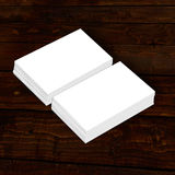 Blank white paper business card collection on wood. Business card bundle on wood, white blank business card, Blank corporate identity package business card on Royalty Free Stock Images
