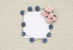 Blank white paper card with blue paper flower frame and pink rose stock image