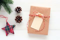 Blank white paper card on brown vintage gift box on white wood background, Christmas, new year, valentine`s day and anniversary. Greeting card background royalty free stock image