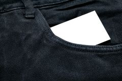Blank white paper or card in front pocket of black jeans with copyspace for sale text or business concept stock photos