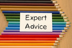 Blank white paper and colored pencil on wooden background. Expert advice text concept and colored pencil on wooden background Stock Image
