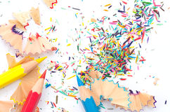 Blank white paper covered in colored pencils sharpening leftover Stock Image