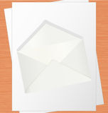 Blank White Paper And Envelope On Oak Table. Communication Concept Royalty Free Stock Photography