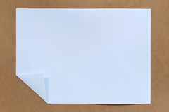 Blank white paper fold. Blank white paper fold placed on a brown background Stock Photo