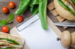 Blank white paper with fresh homemade sandwich on wooden table b. Ackground. Top view with copy space stock photos