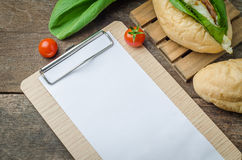 Blank white paper with fresh homemade sandwich on wooden table b. Ackground. Top view with copy space royalty free stock photo