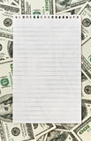 Blank white paper over money background Stock Photo
