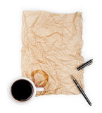 Blank white paper with pen and a half-empty cup of coffee, Stock Images