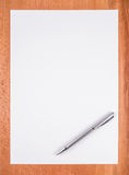 Blank white paper with pen Stock Image