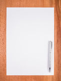 Blank white paper with pen Stock Photo