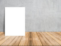 Blank white paper poster on plank wooden floor and concrete wall, Template mock up for adding your content Royalty Free Stock Photos