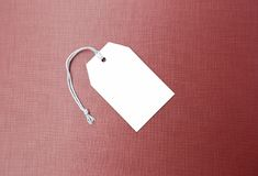 Blank white paper price and sale tag on red texture background stock photos